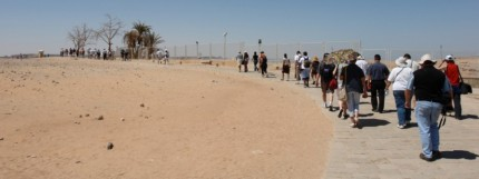 The tourists trek through the desert to Abu Simbal