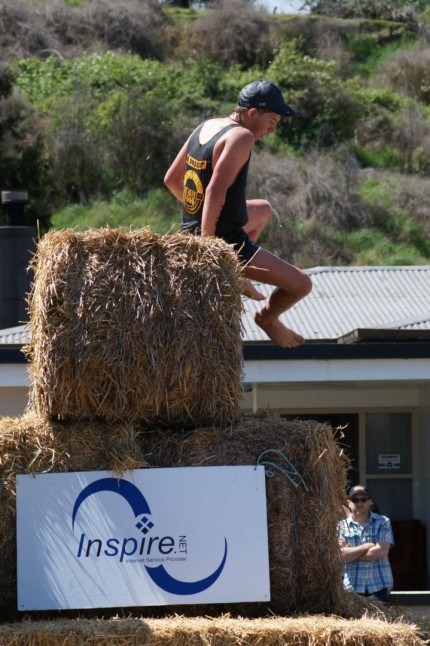 Over the hay bale mountain - three tiers high. Note bare feet - these guys and girls are made of tough stuff.